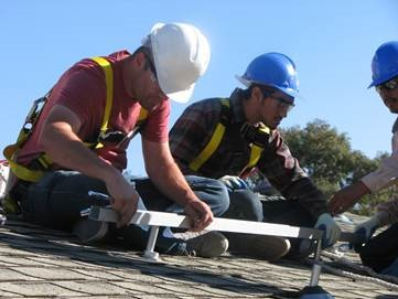 Photovoltaic Students installing roof mounts for solar equipment